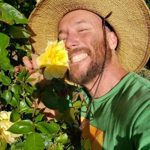 Casey O'Neill poses proudly with a flower. Photo taken from HappyDay Farms Facebook page.