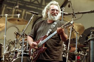 jerry garcia playing a guitar