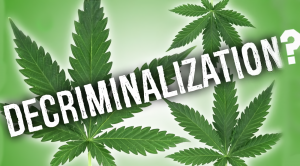 The cannabis leaf, questioning the meaning of decriminalization.