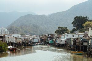 wooden shanties along the riverbank